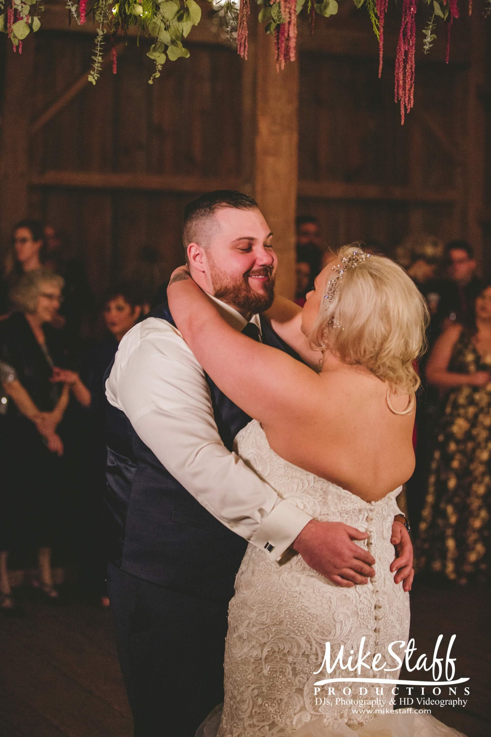 bride and groom's first dance at barn wedding reception