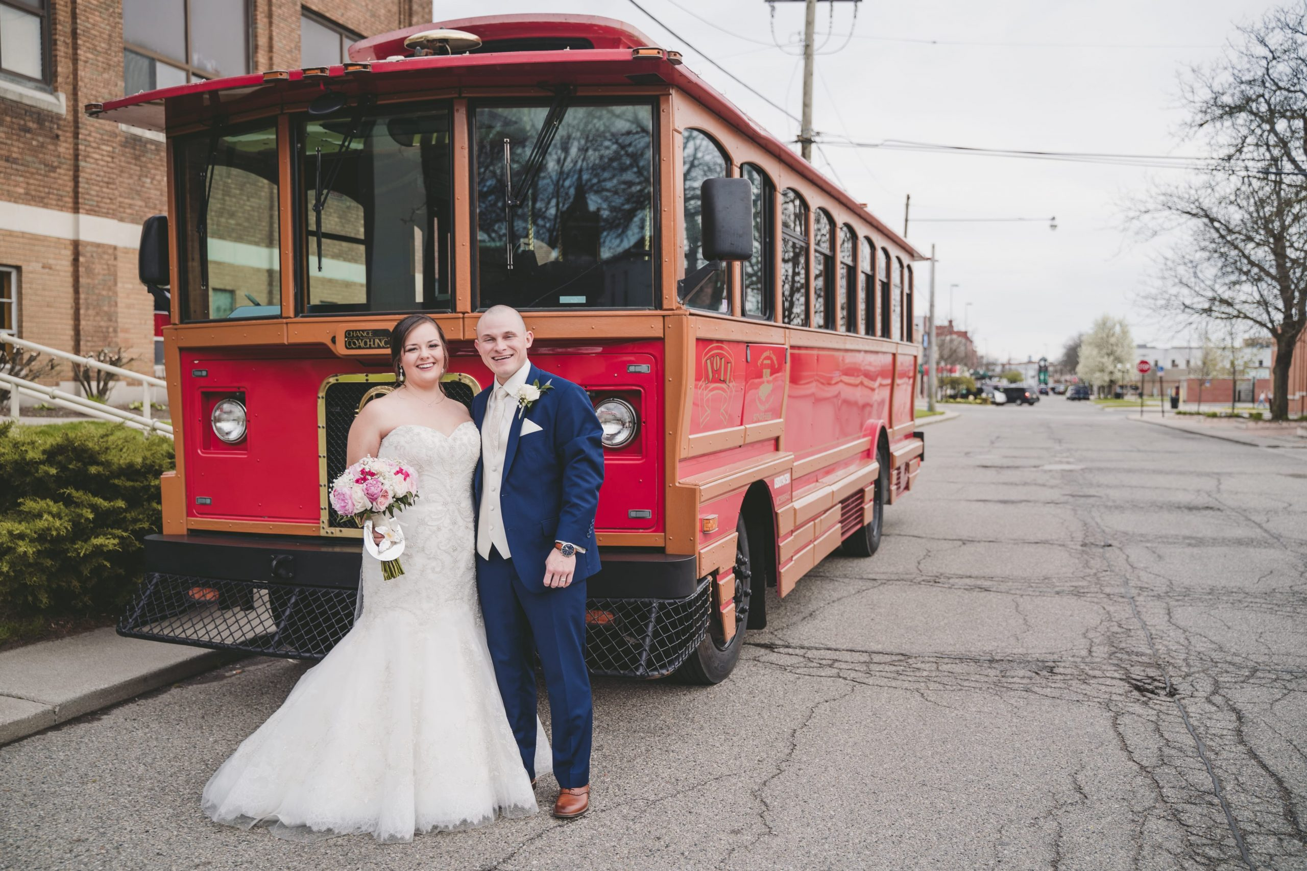 bride and groom in front of trolley