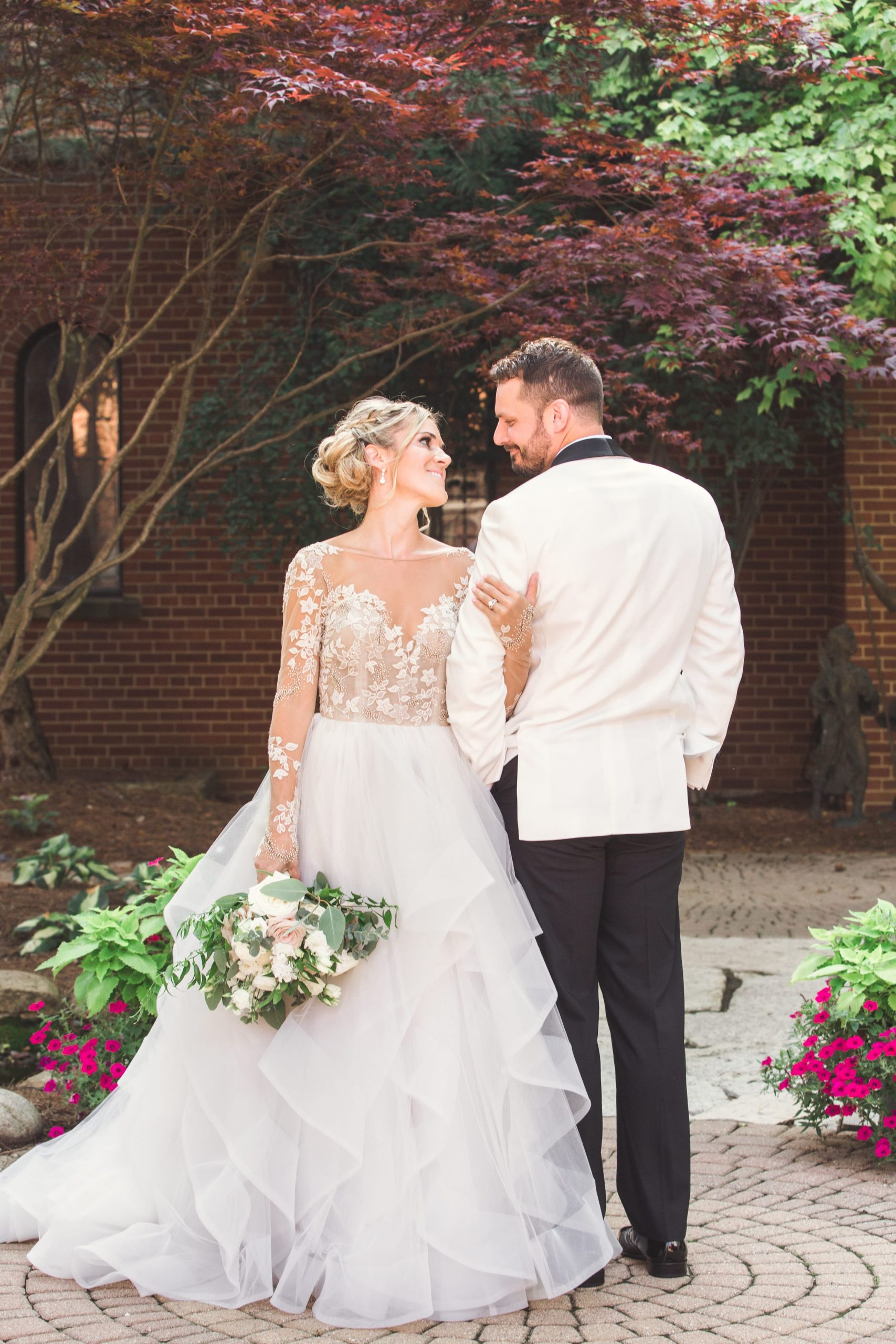bride and grooms arms interlocked