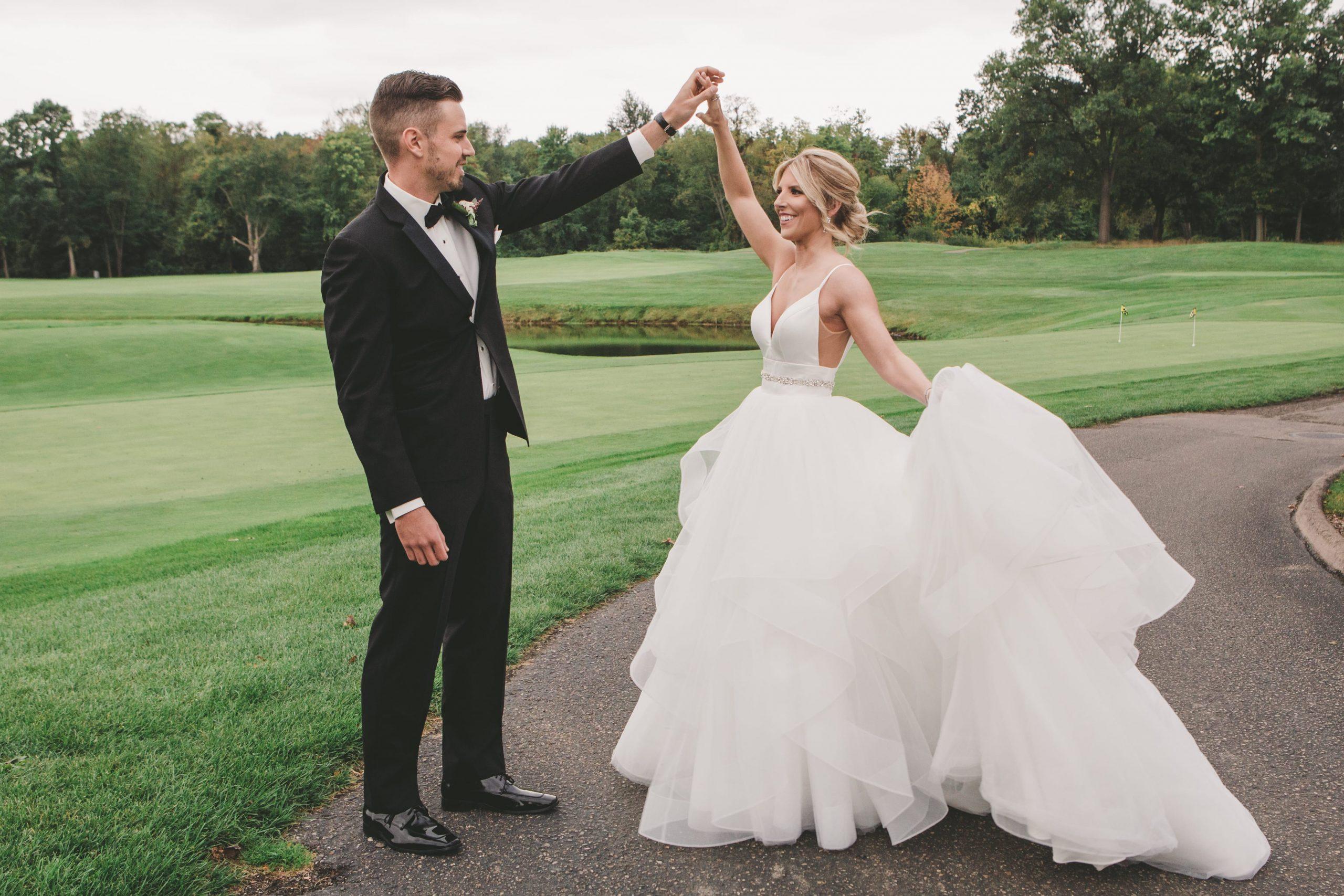 groom spinning bride at Cherry Creek