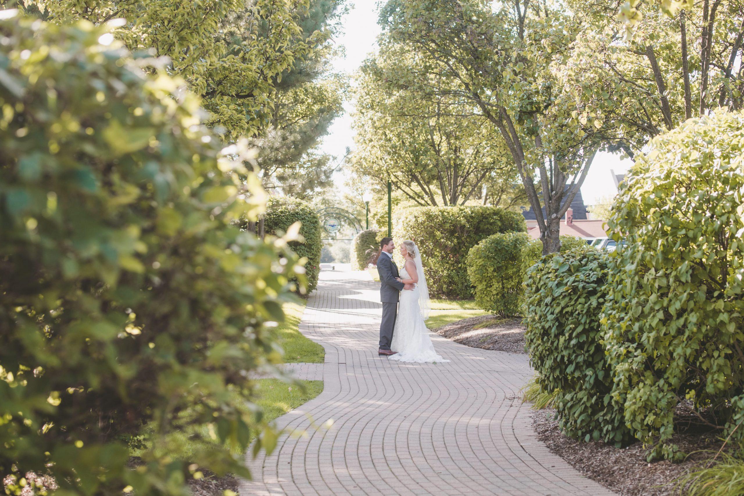 romantics outside on stone path