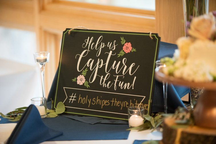 wedding hashtag on sign at reception