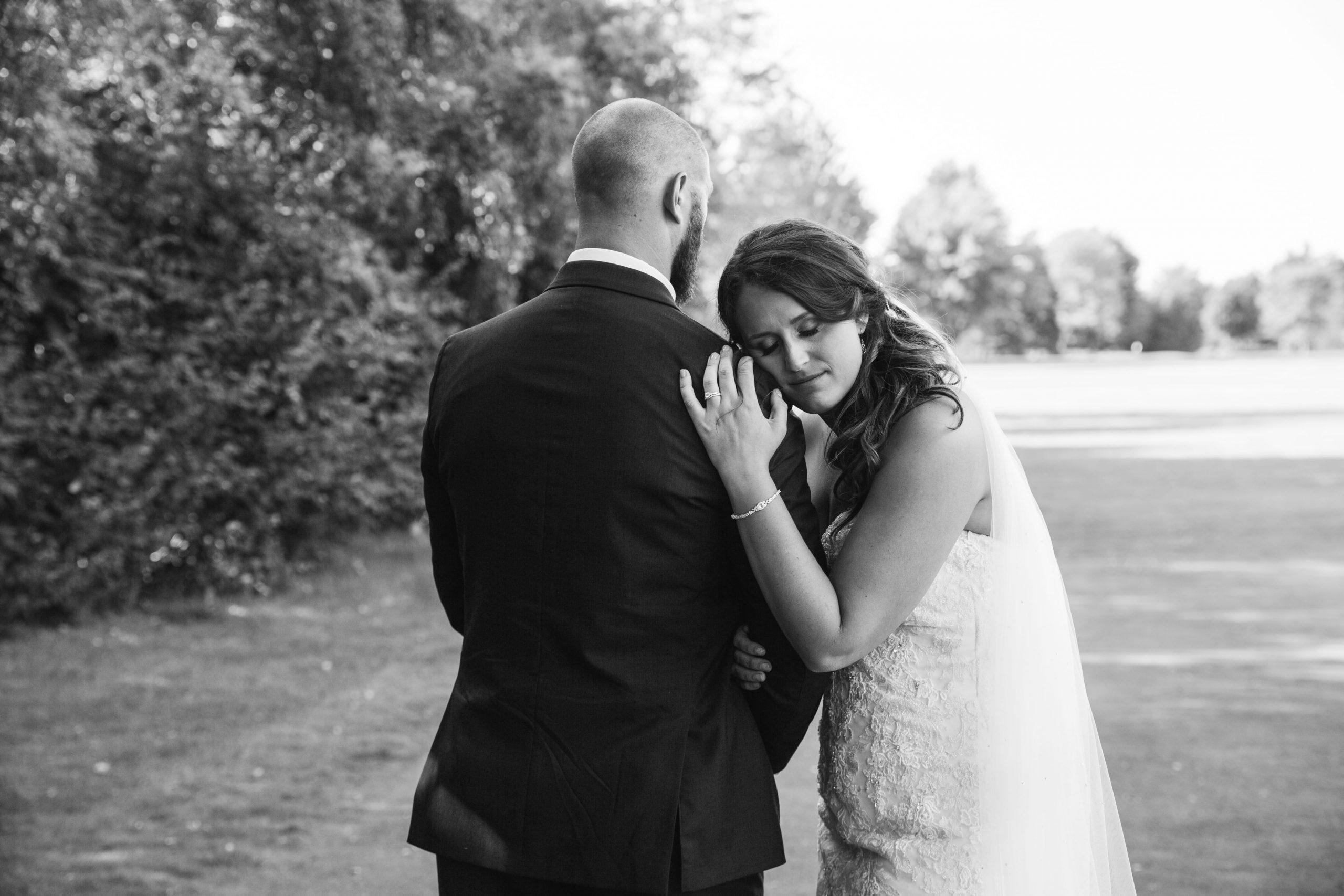 bride leaning head on groom's shoulder