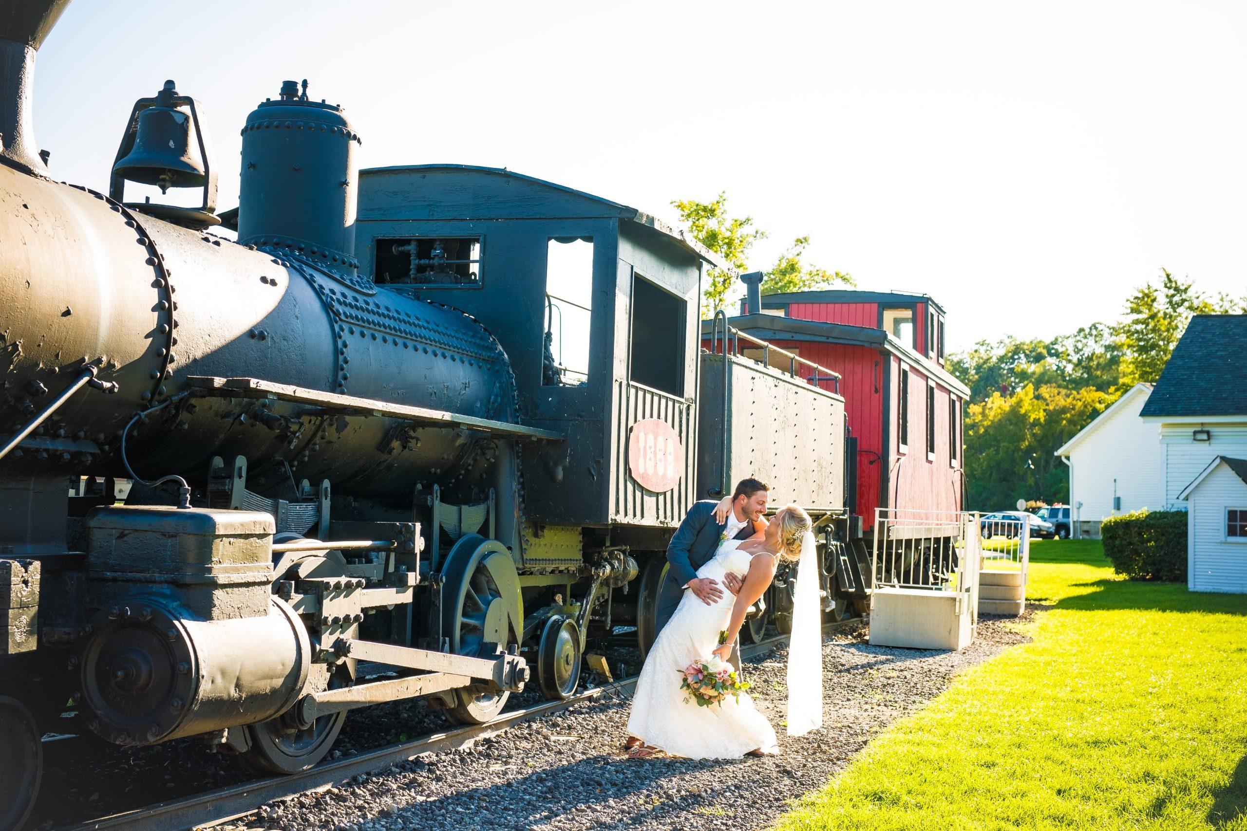 wedding day romantics by a train