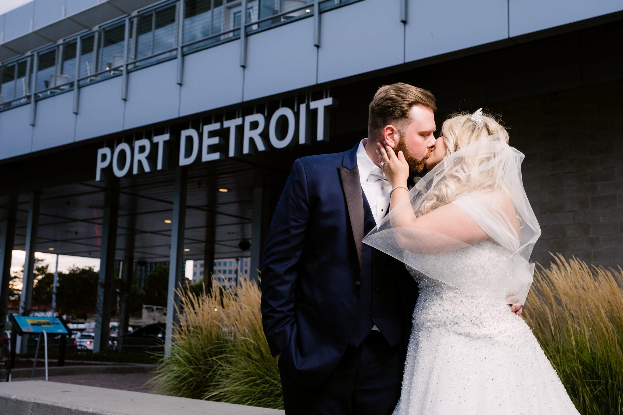 couple kissing outside port detroit