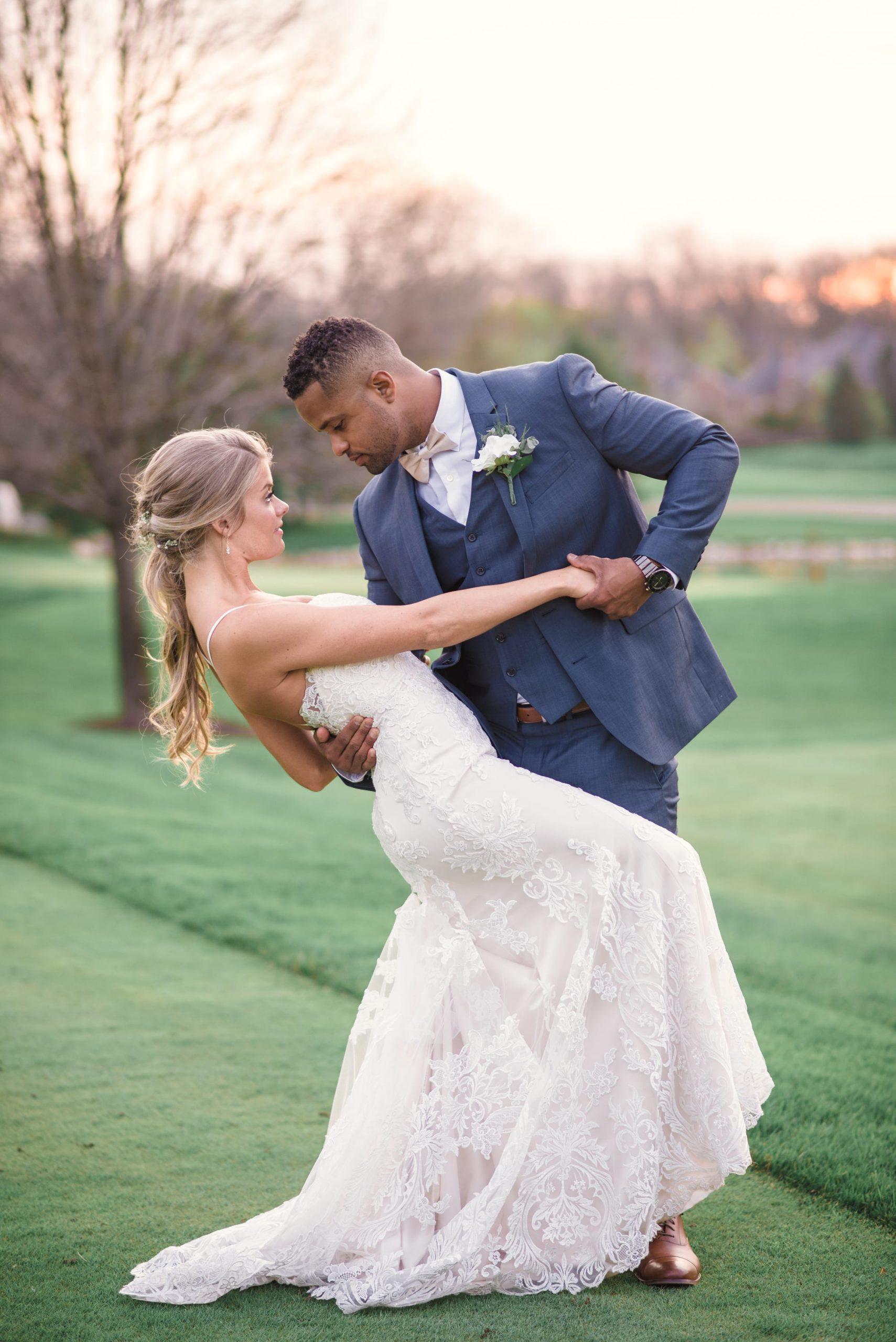 bride and groom wedding photos on golf course