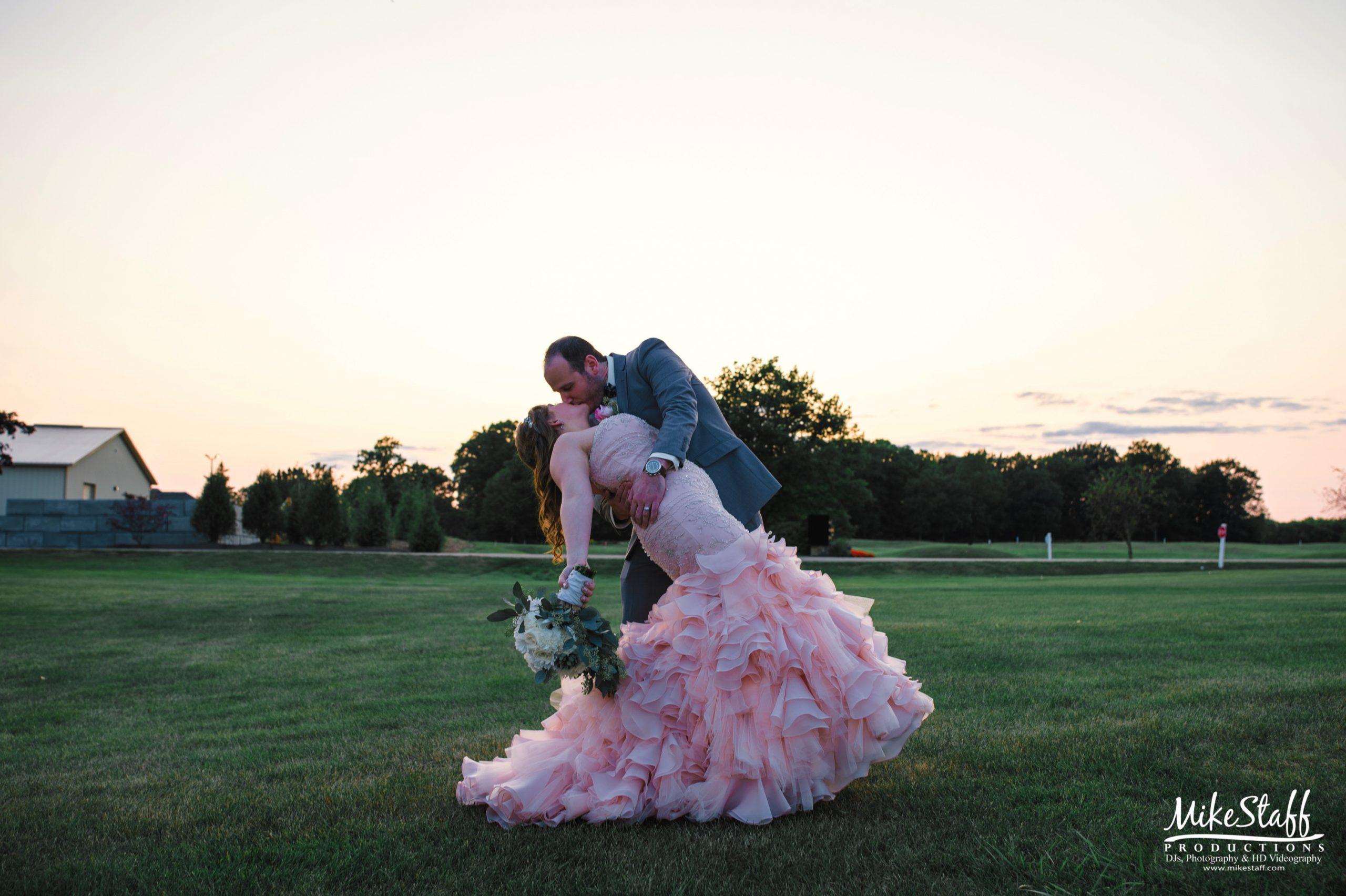 bride in pink wedding dress