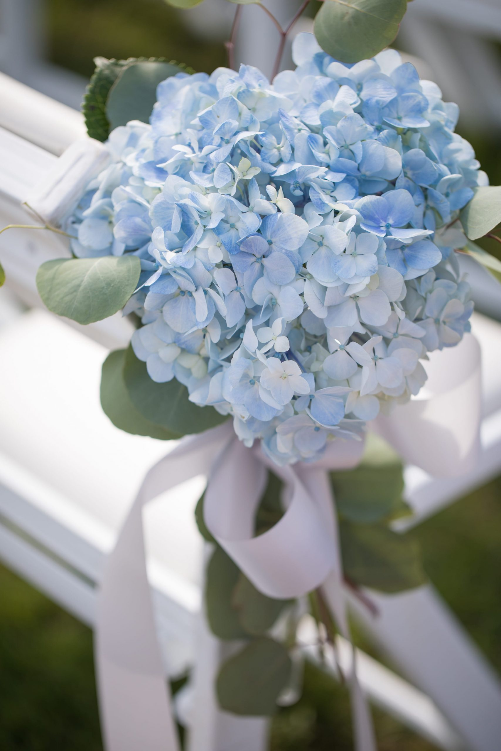 blue floral details on chairs at wedding ceremony