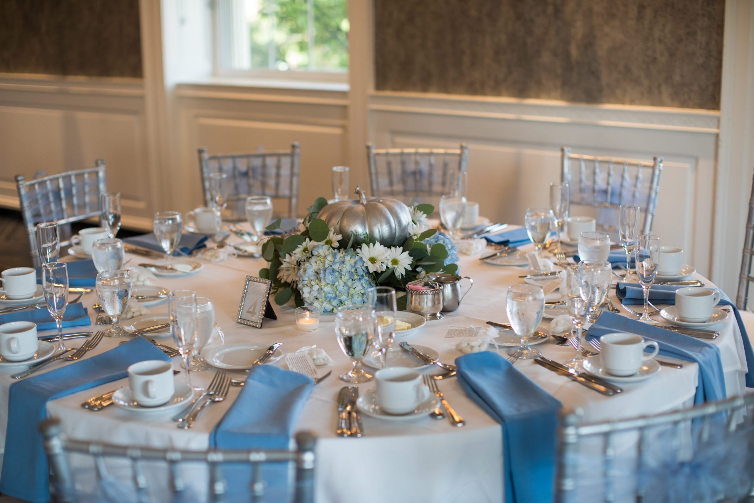 white and blue reception table details