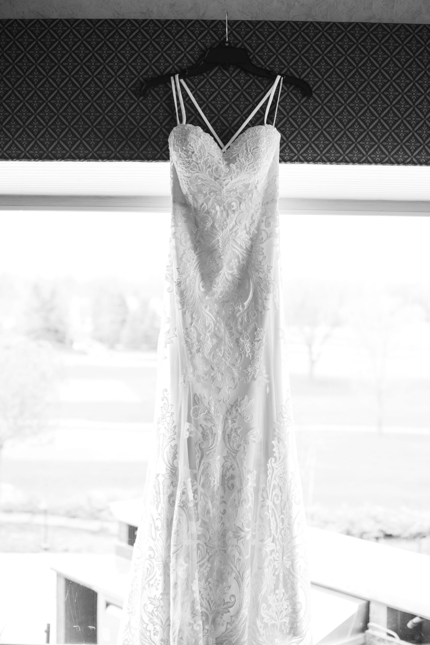 dress hanging from window