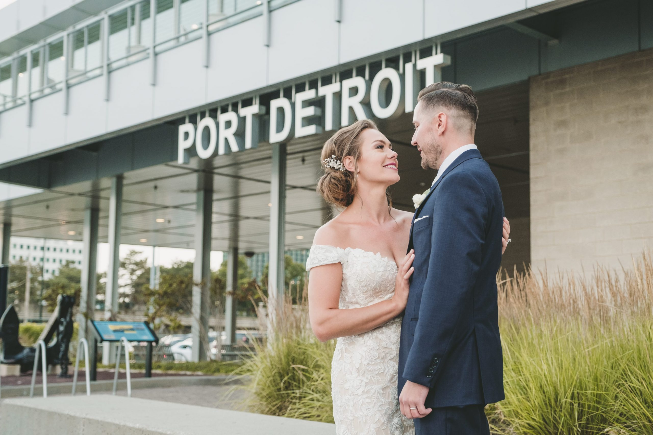 bride and groom outside waterview loft at port detroit