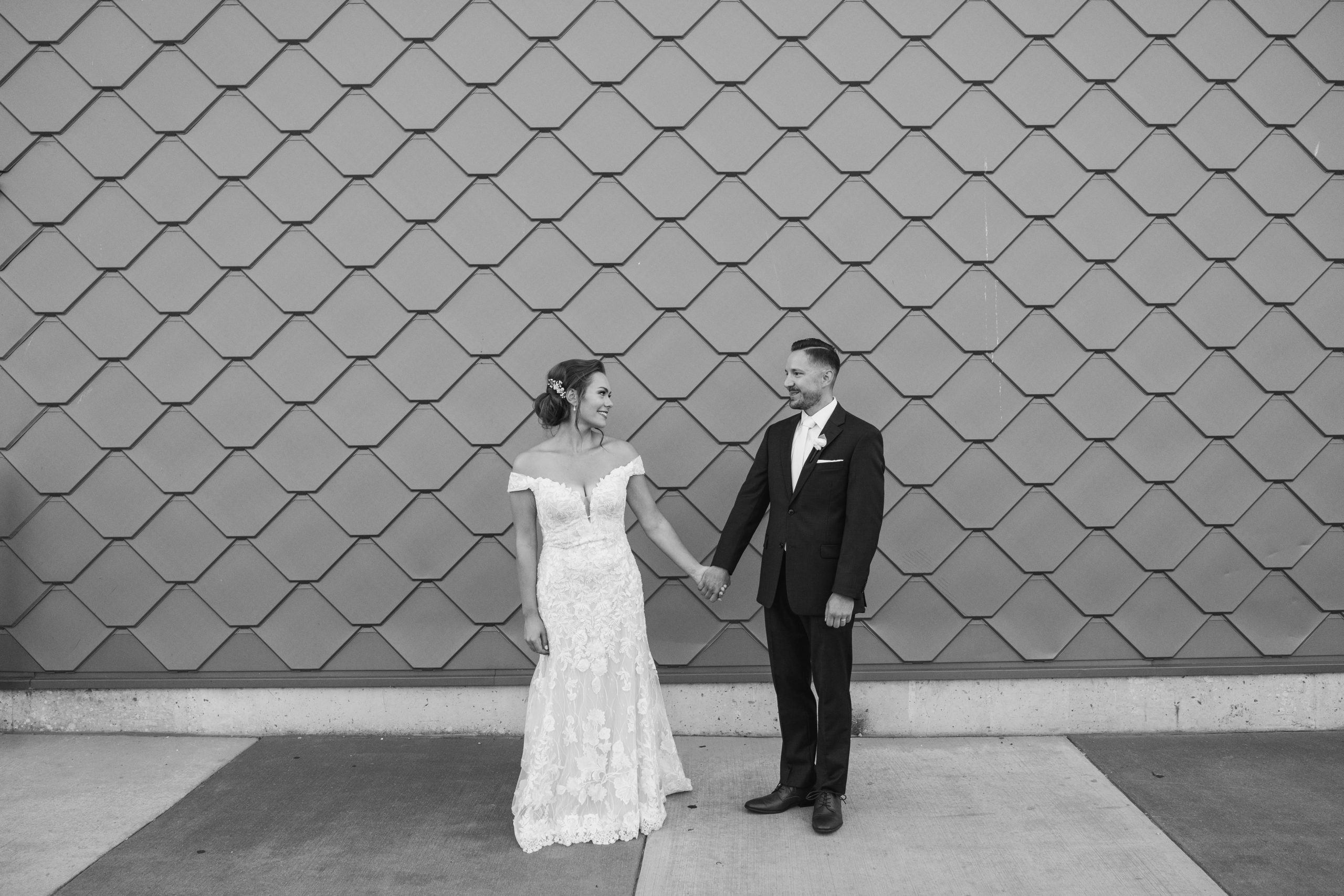 black and white wedding day romantics with artistic wall