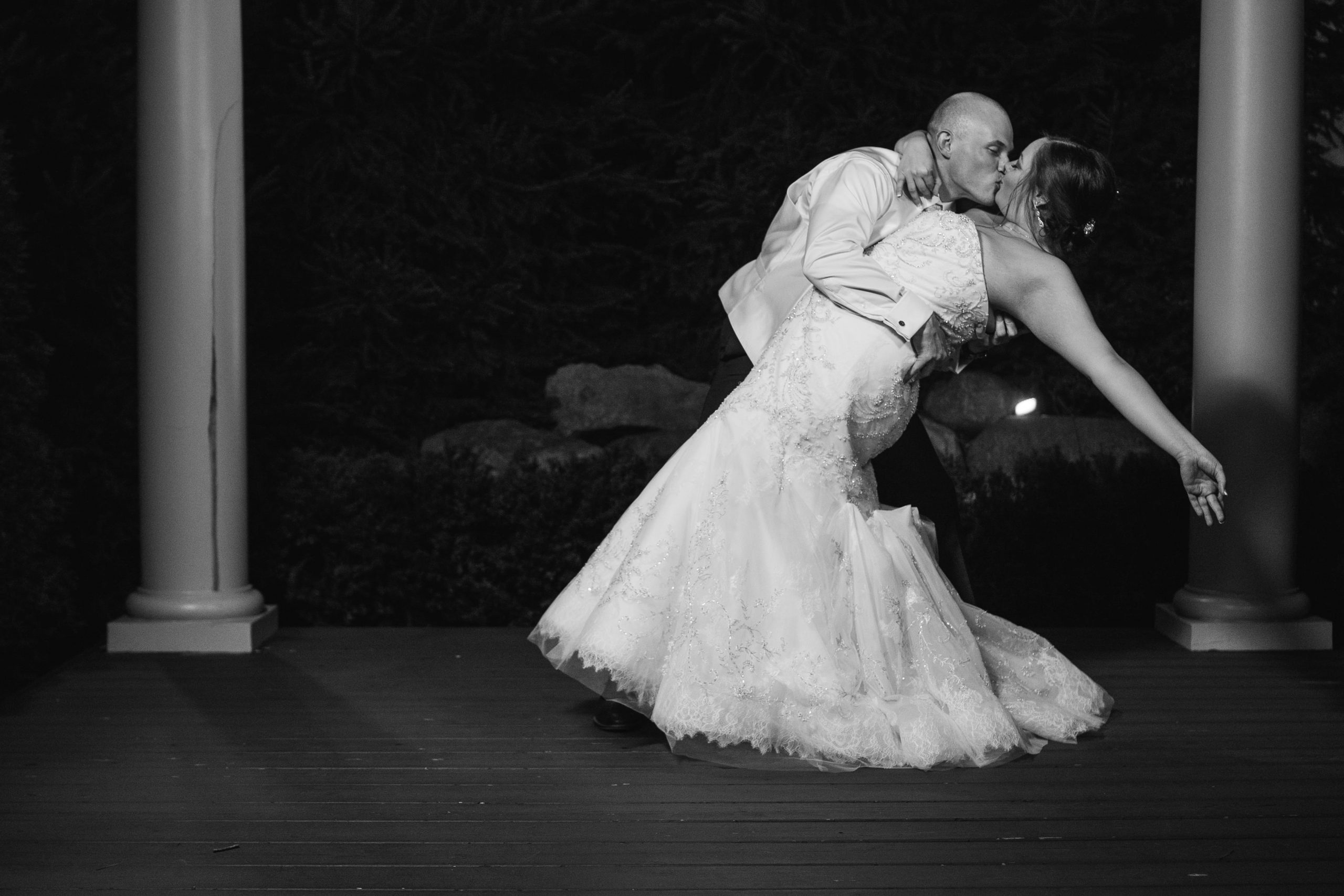 bride and groom kissing during evening romantics