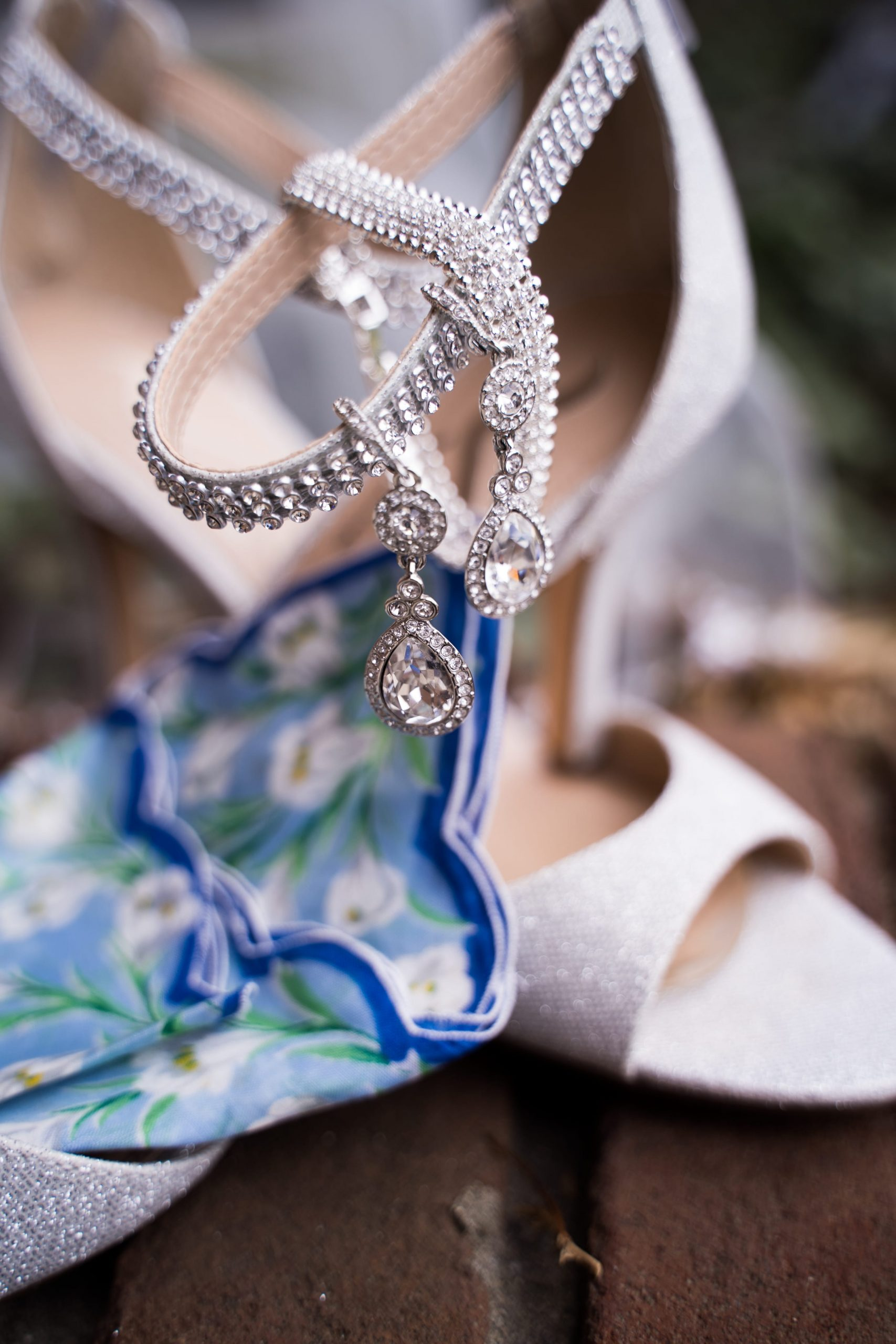 jewelry hanging from brides heels