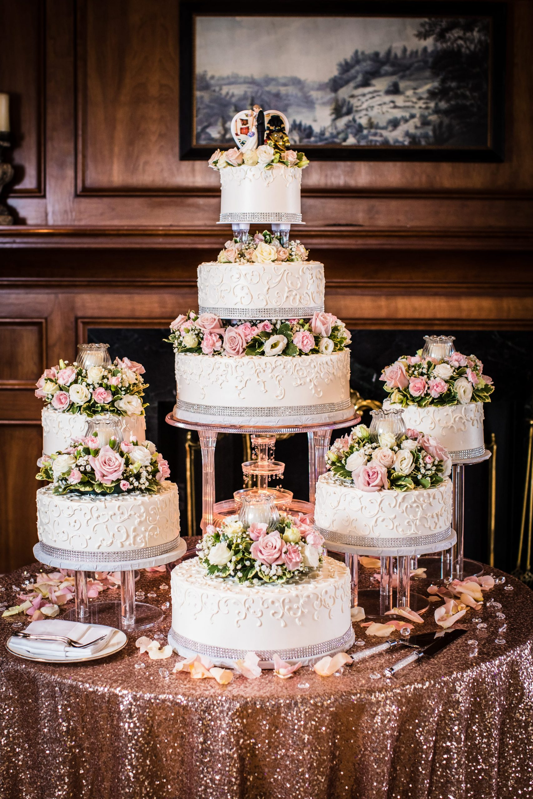 grand wedding cake with rose gold table cloth