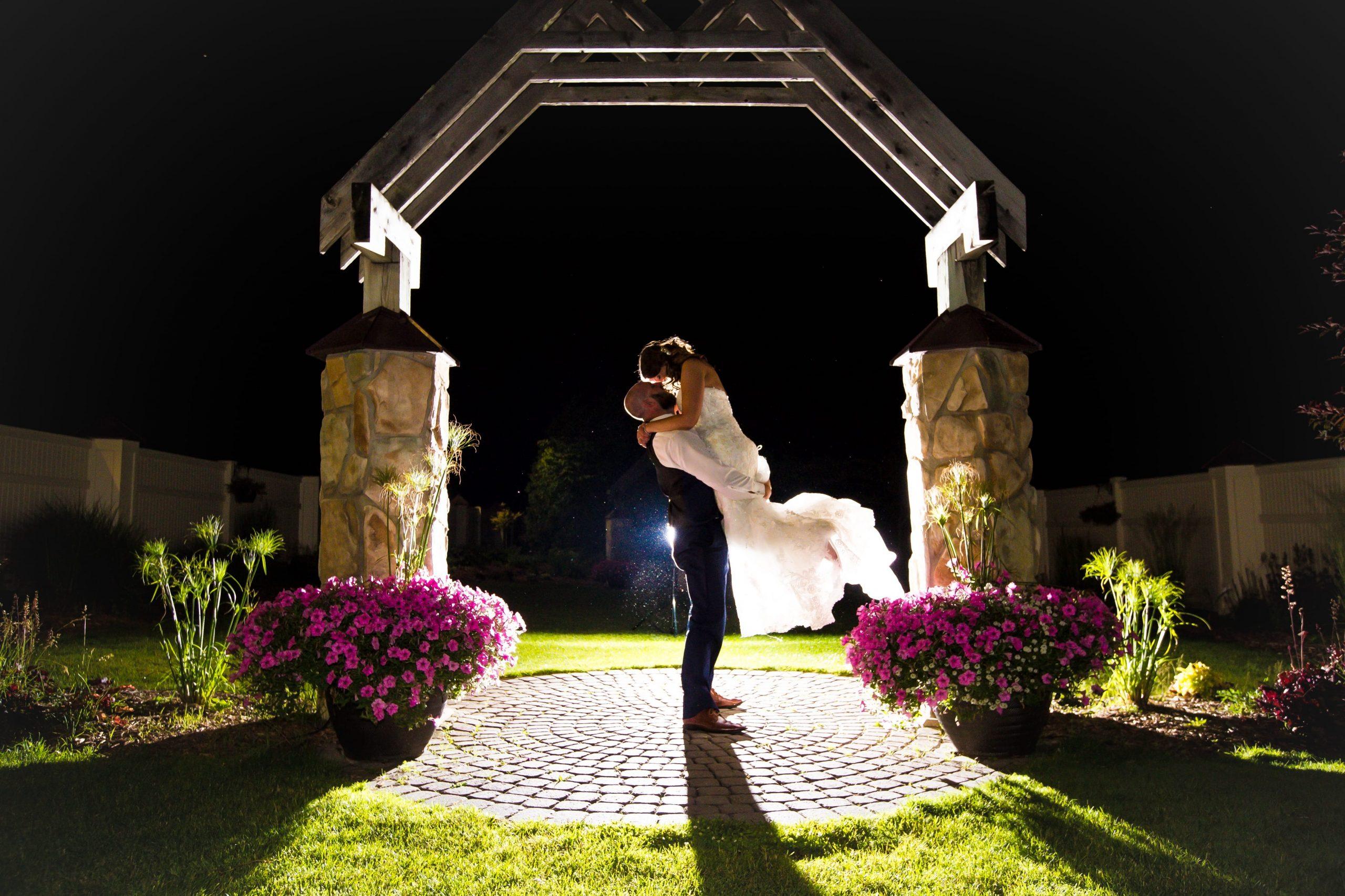 groom lifting bride for evening romantics