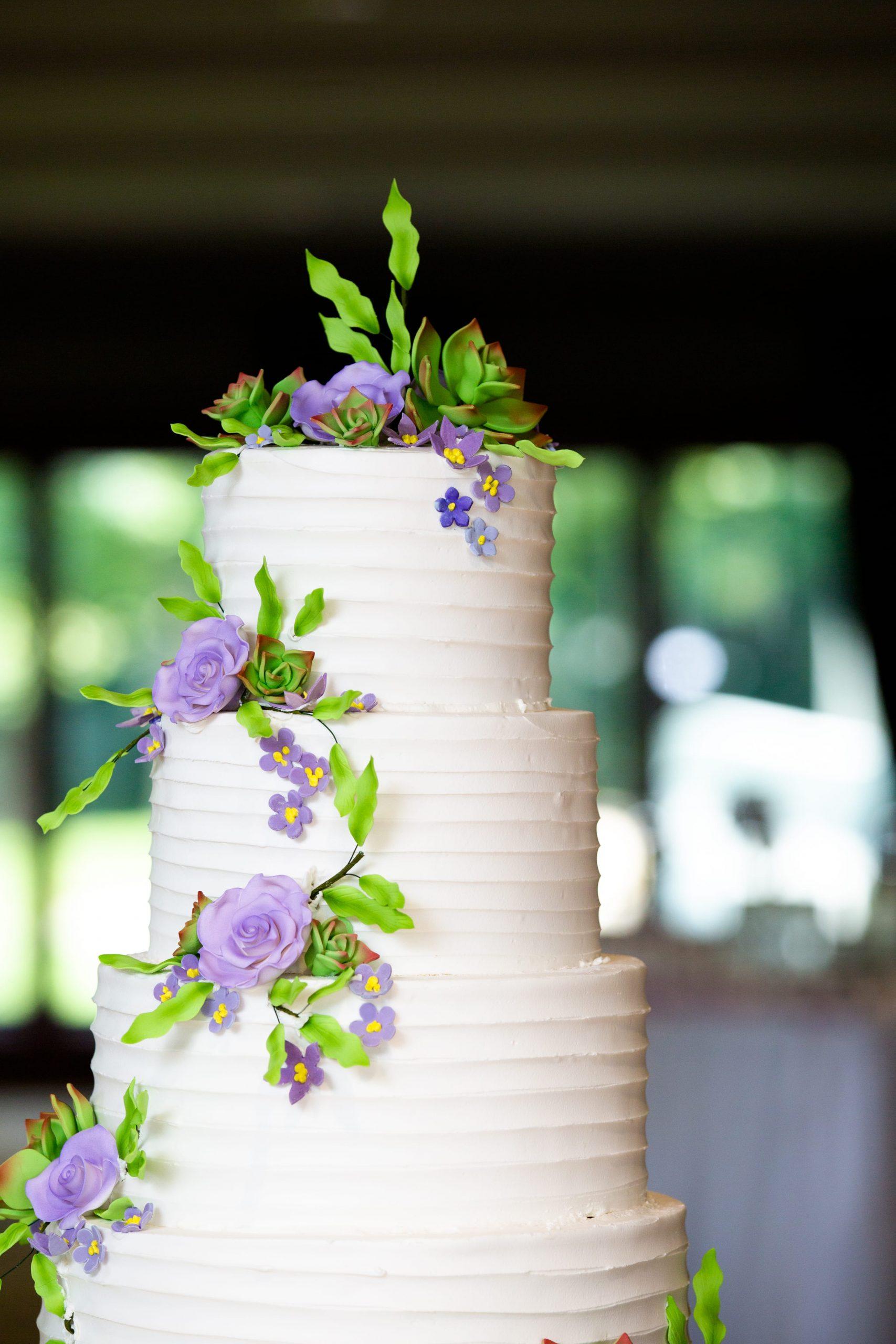 white and purple tiered wedding cake