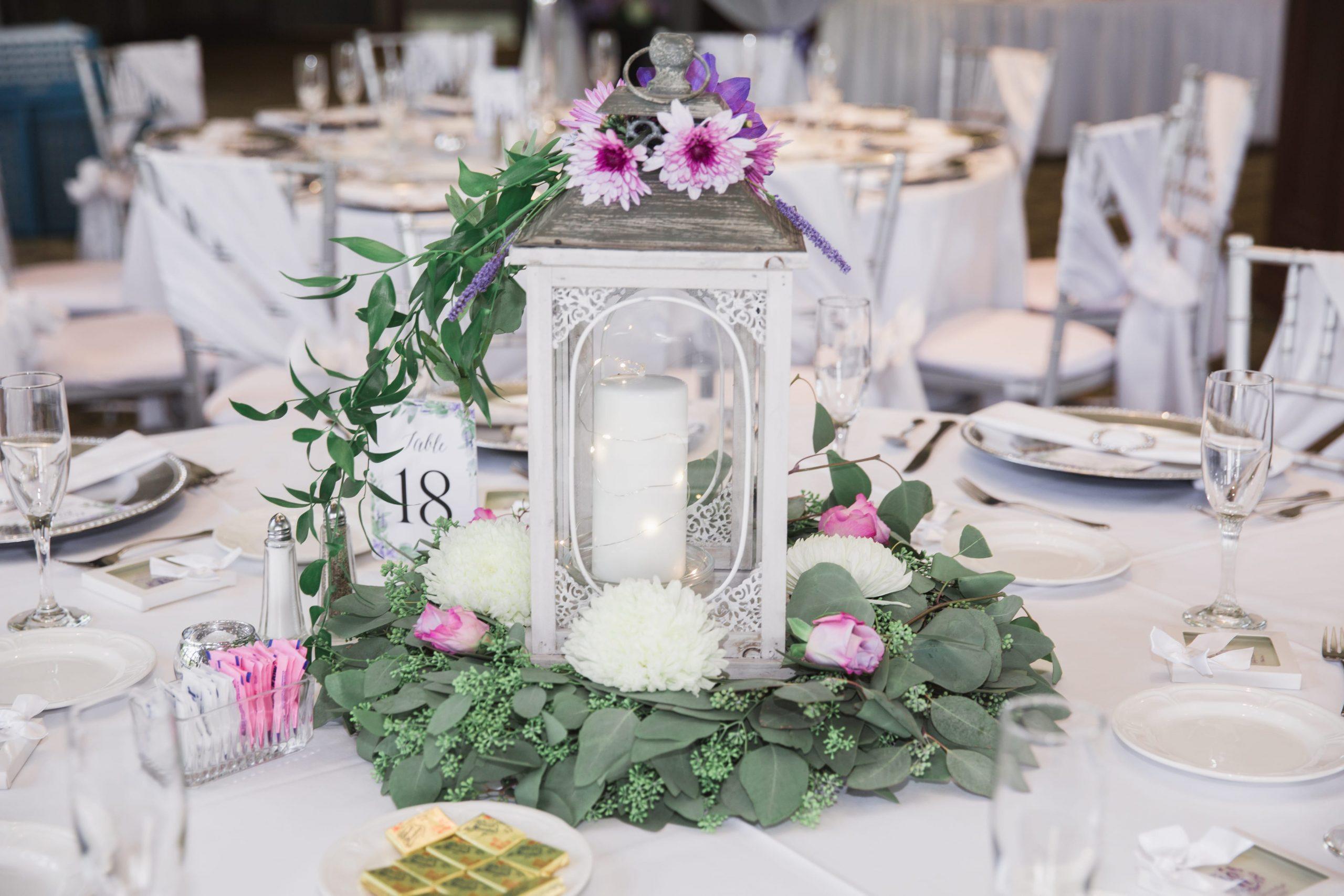 candle and lantern wedding reception centerpiece