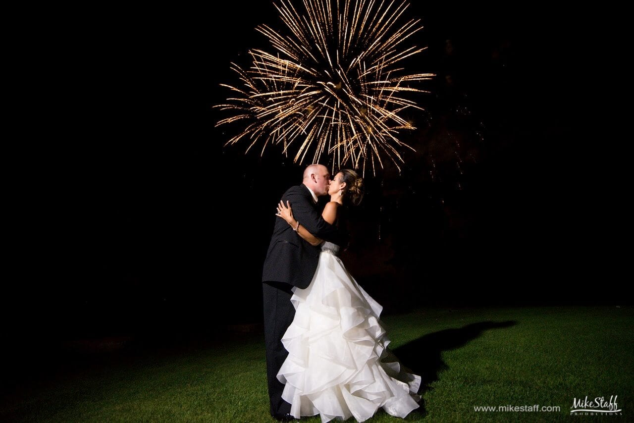 fireworks bride and groom kissing