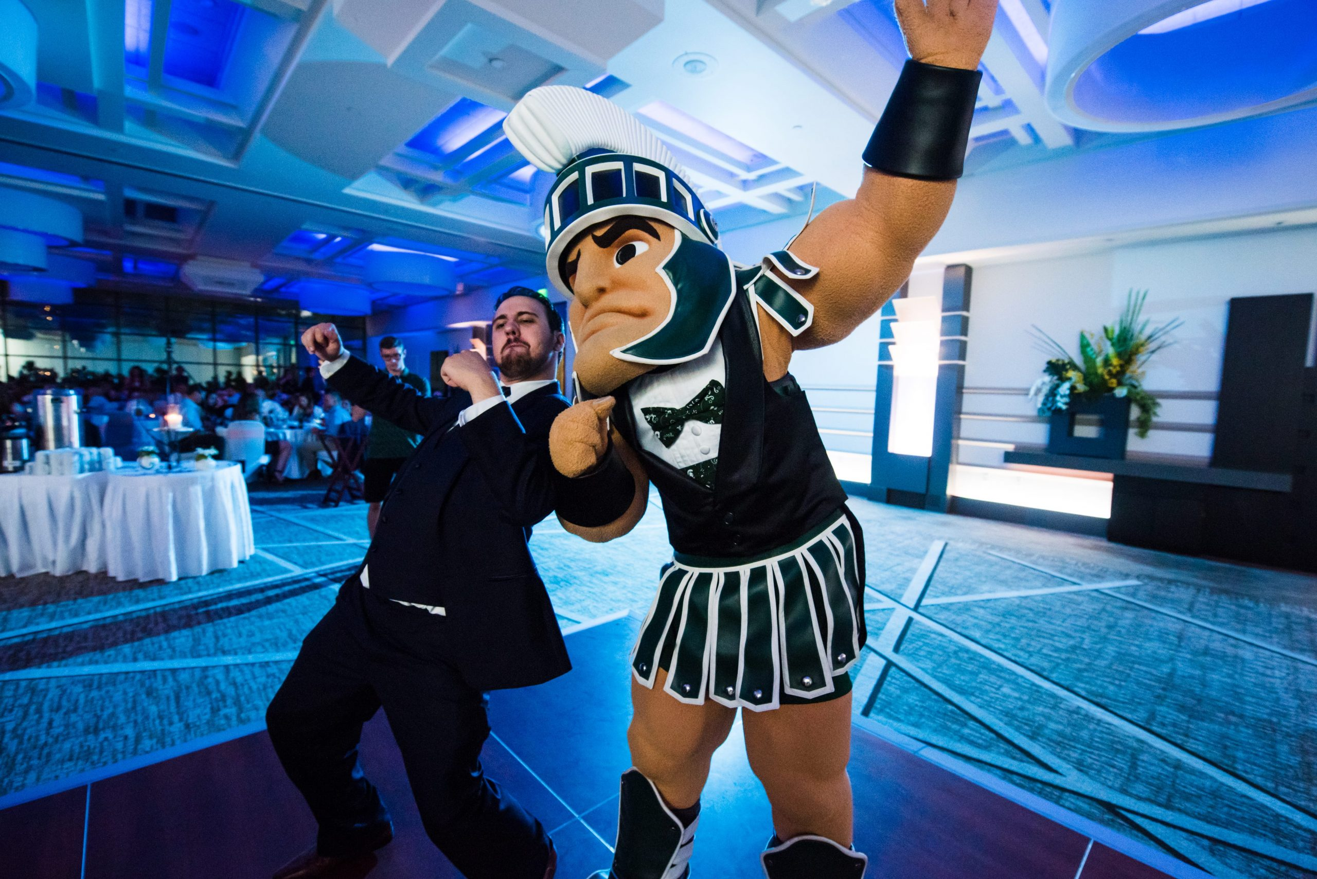 Sparty and groom at wedding reception