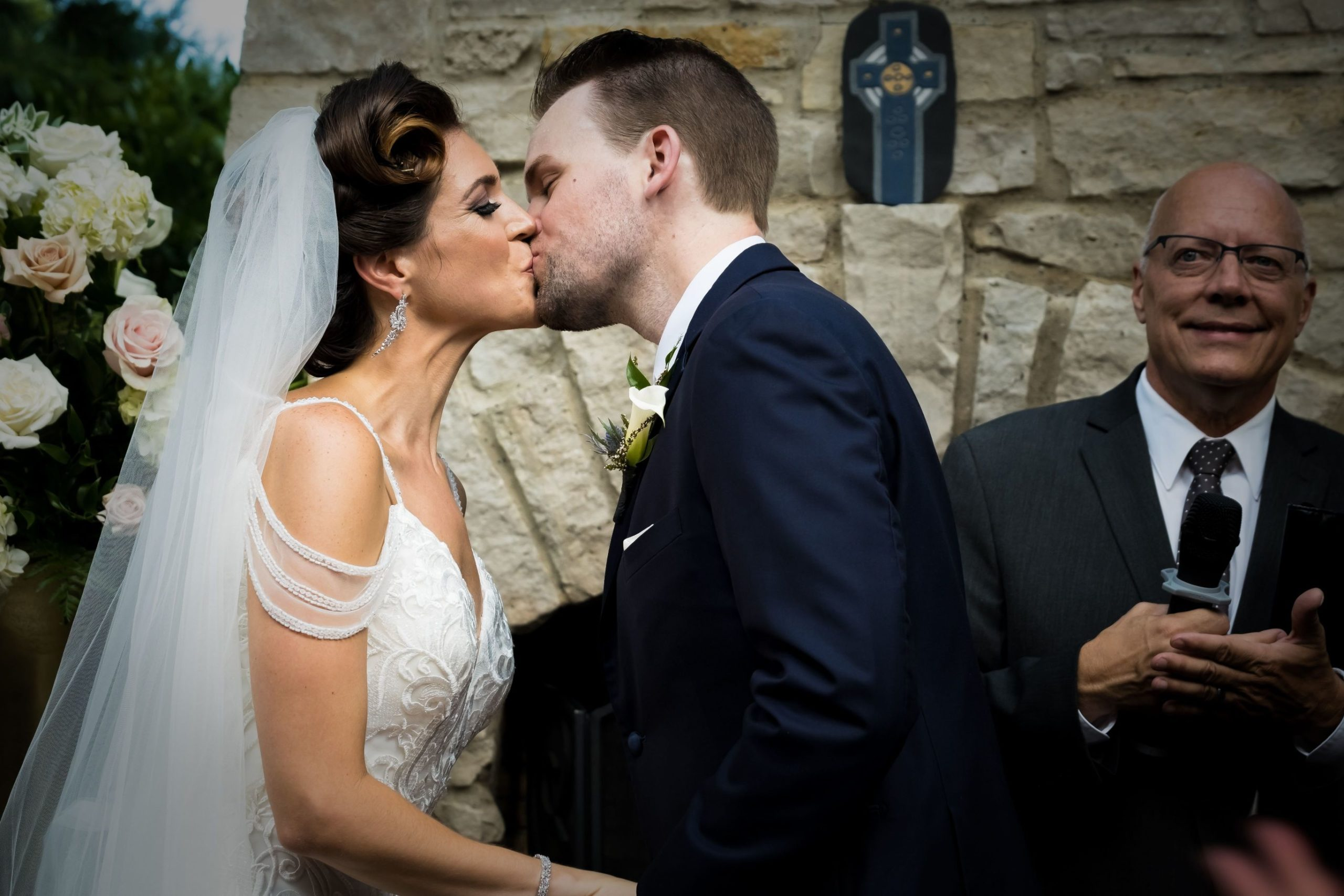 Ashley and Michael kissing at ceremony scaled 1
