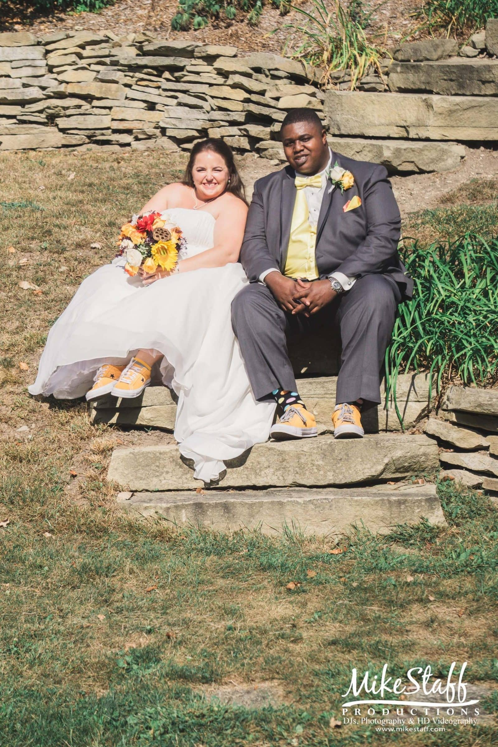 Aleah and Anthony sitting on stone