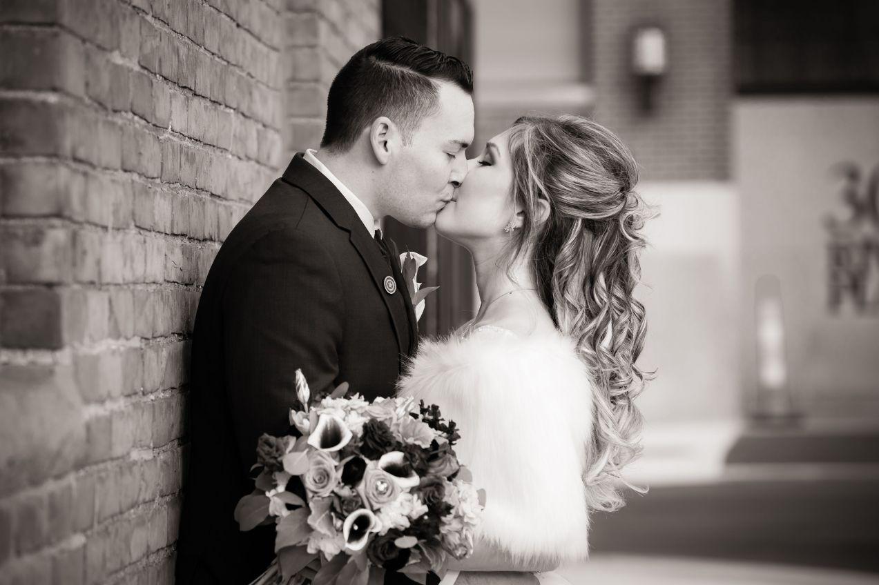 black & white image of ashley and tom kissing