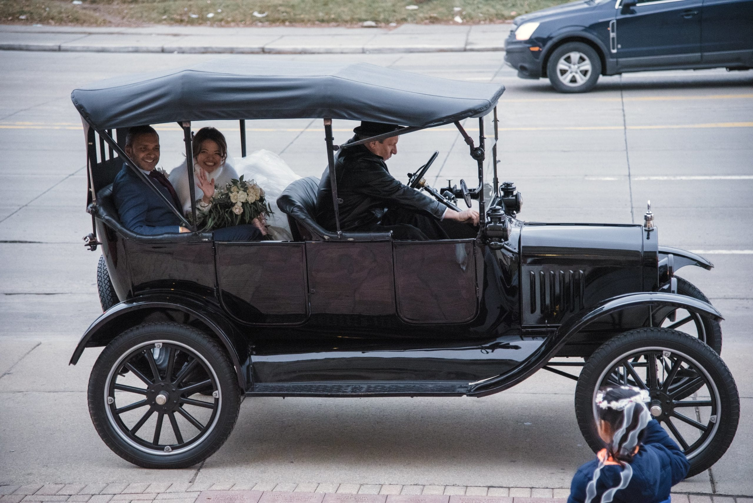 bride and groom in Ford Model T