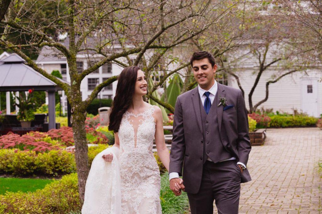 bride and groom walking through wellers