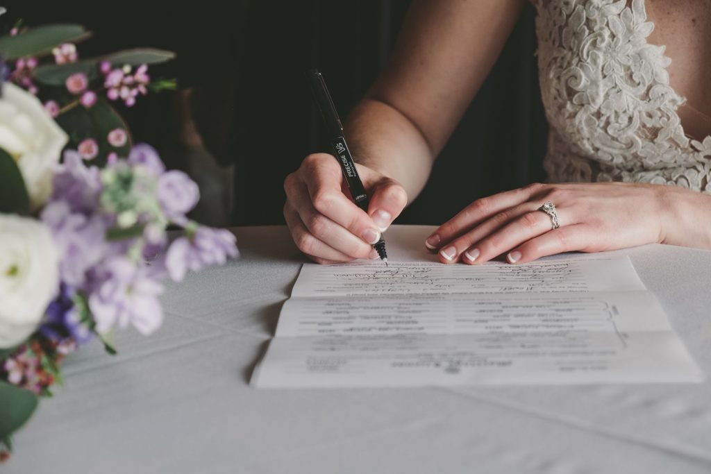 bride signing the marriage licnese
