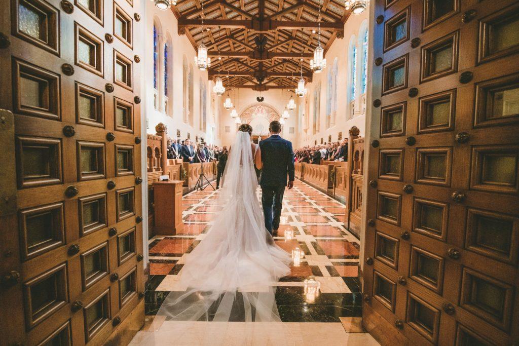 bride walking down aisle at inn at st johns