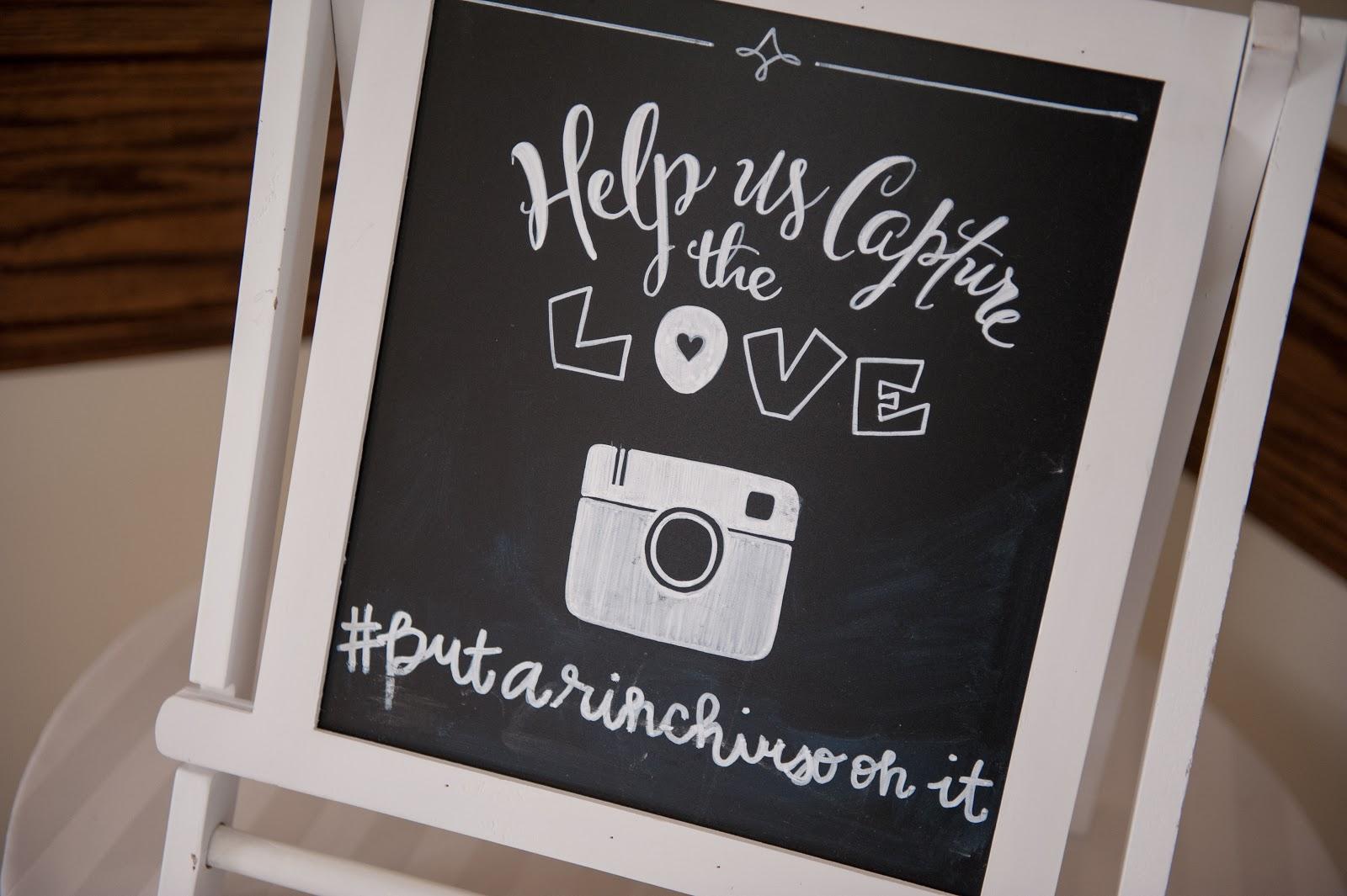 Hashtag photo sign at wedding