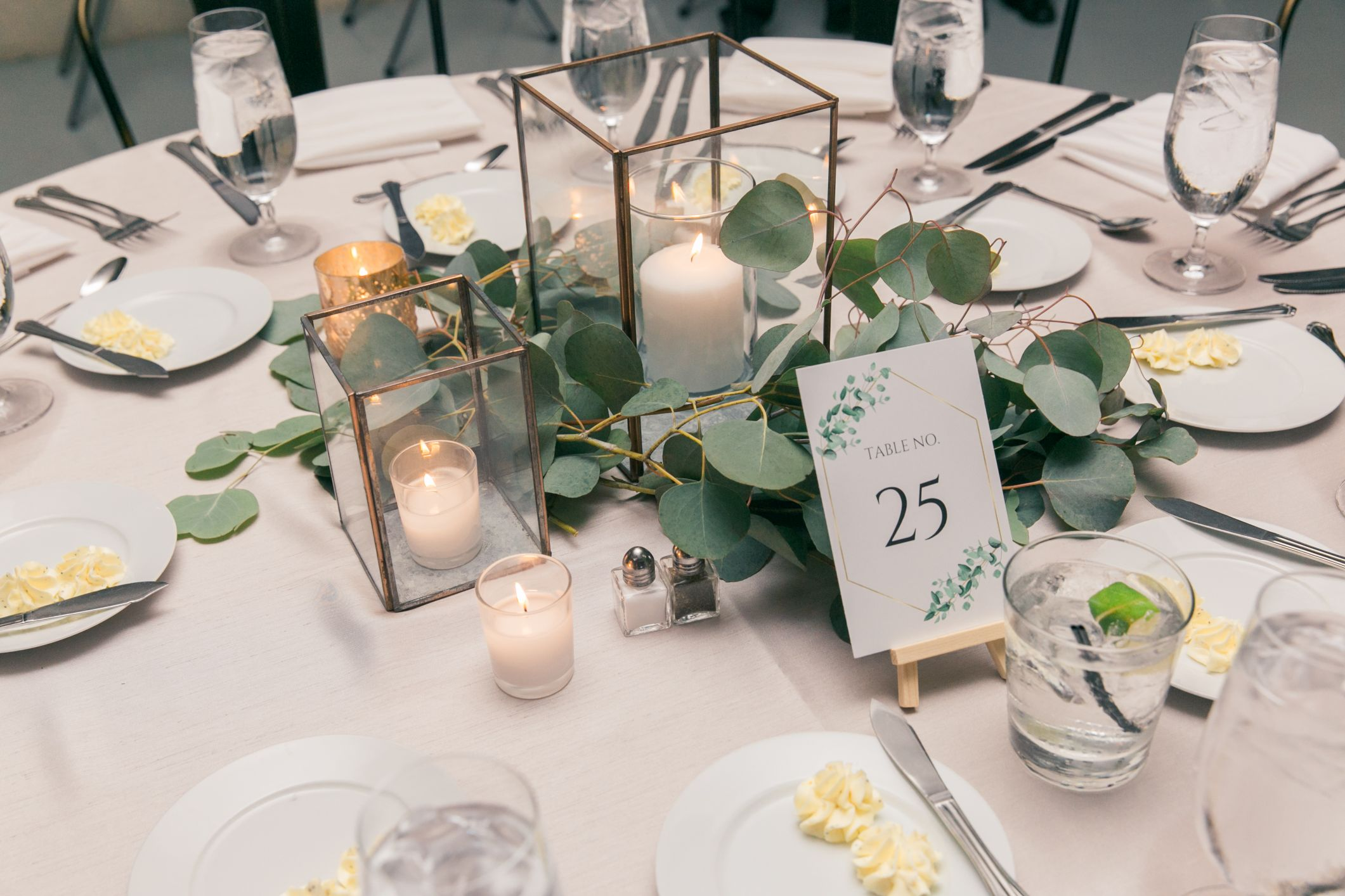 centerpiece with candles and greenery
