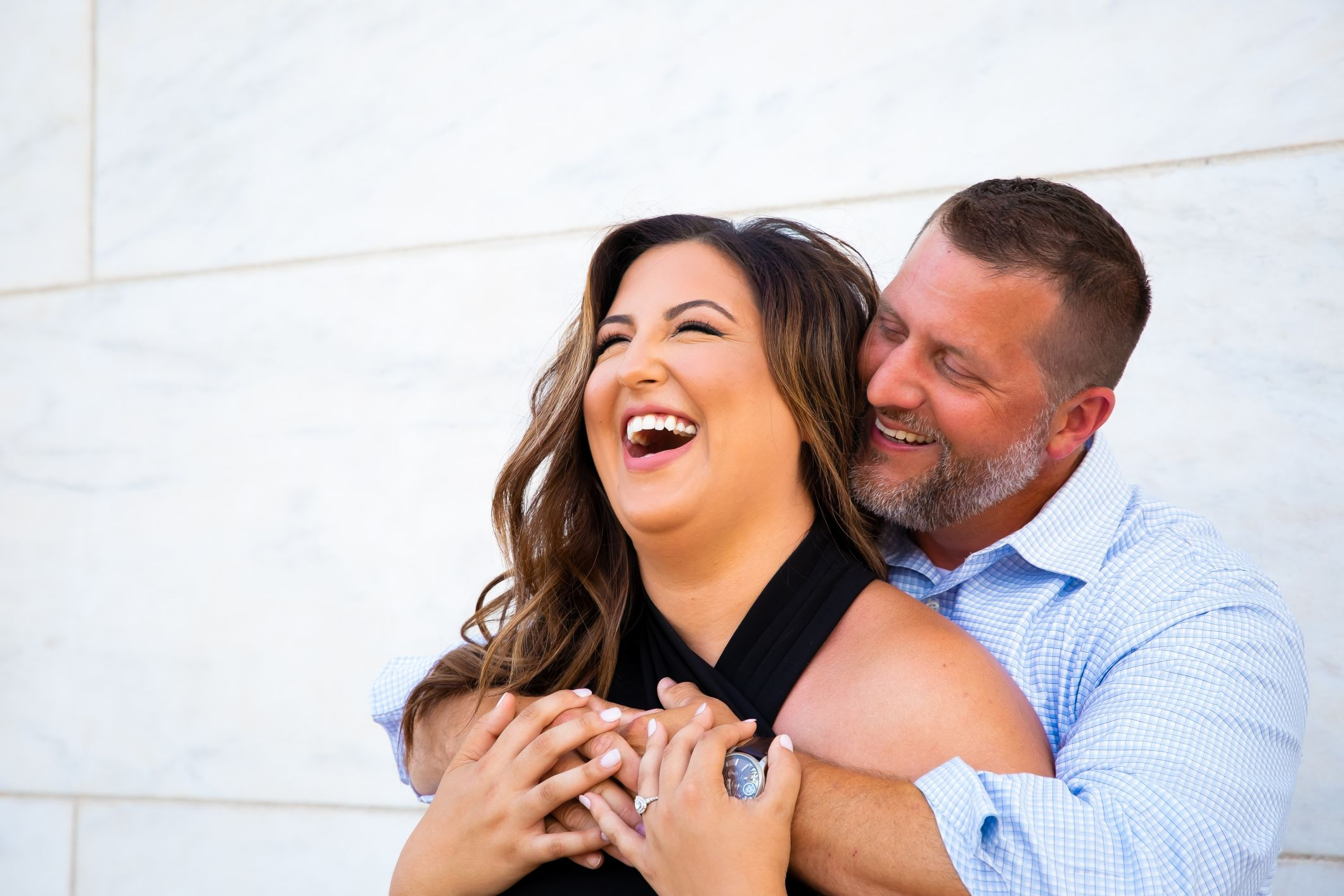 couple laughing at engagement session