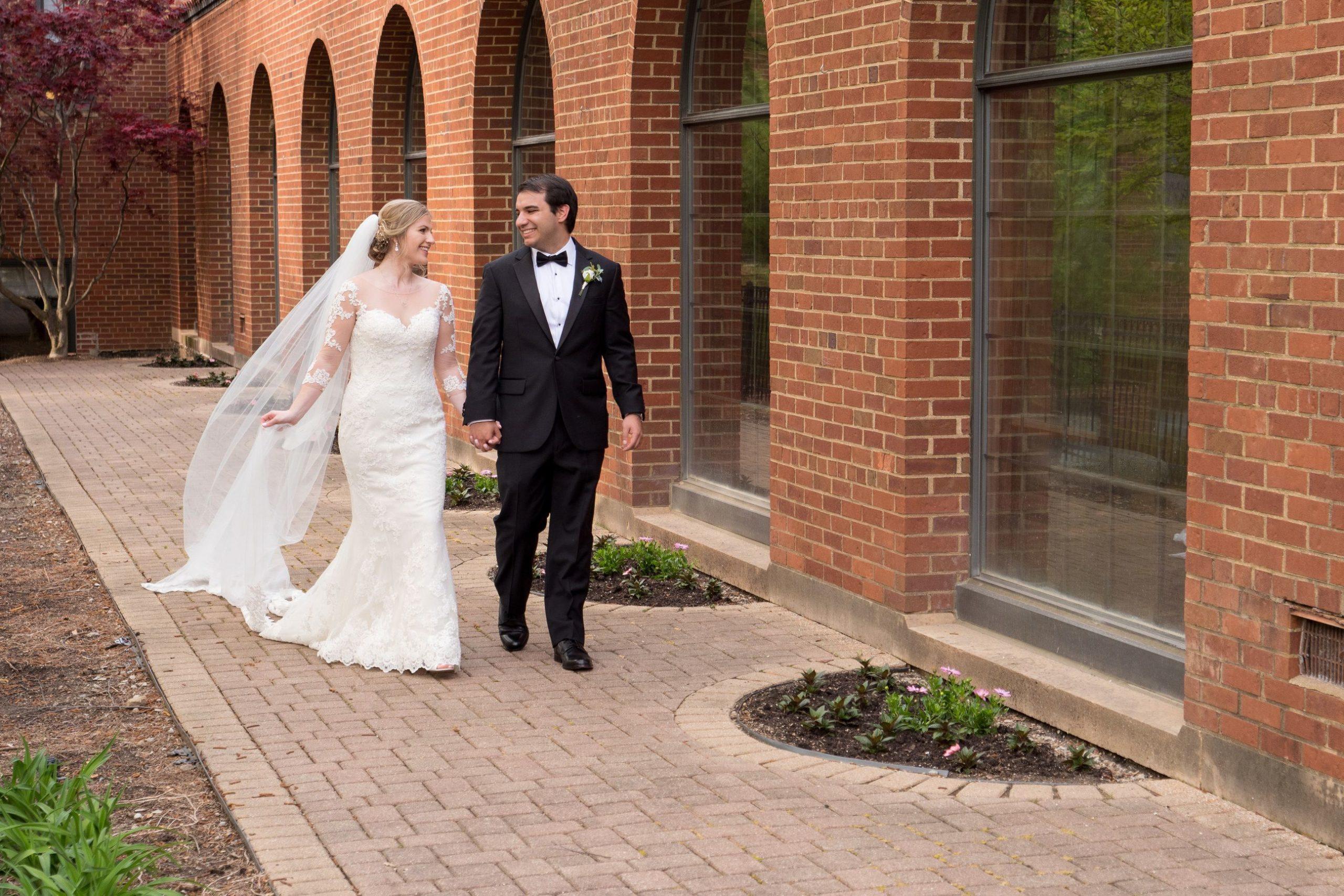 couple walking outside inn at st johns
