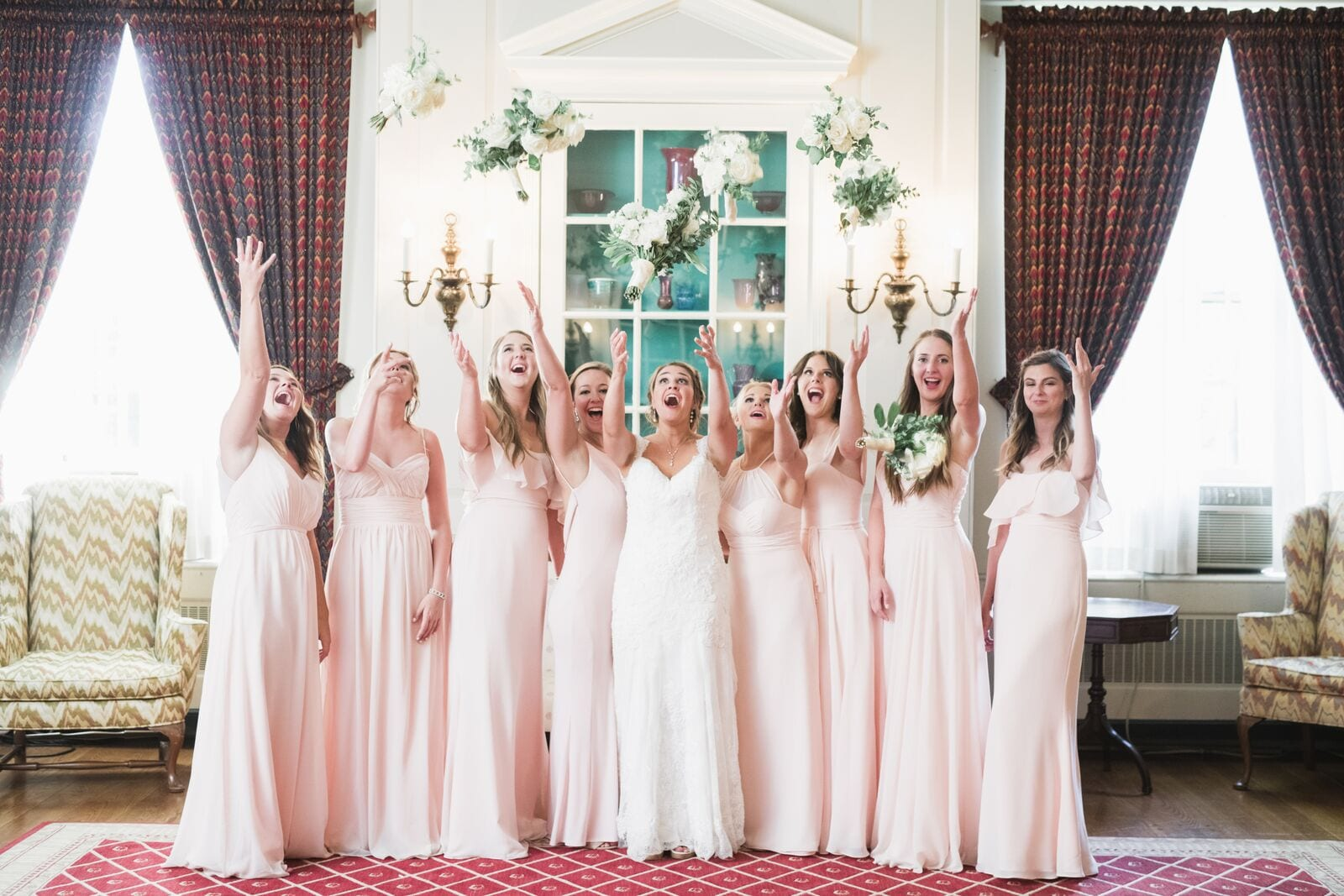 bridesmaids tossing bouquets