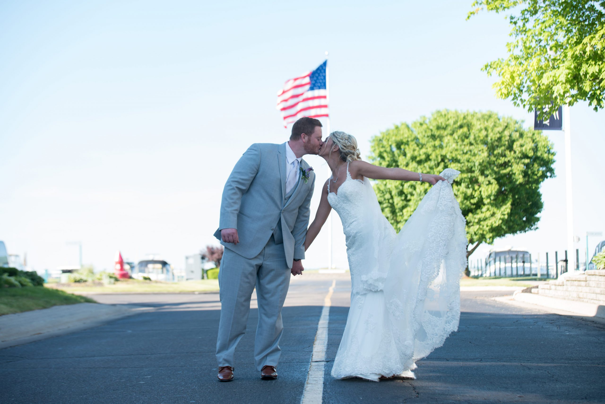 bride and groom with american flag