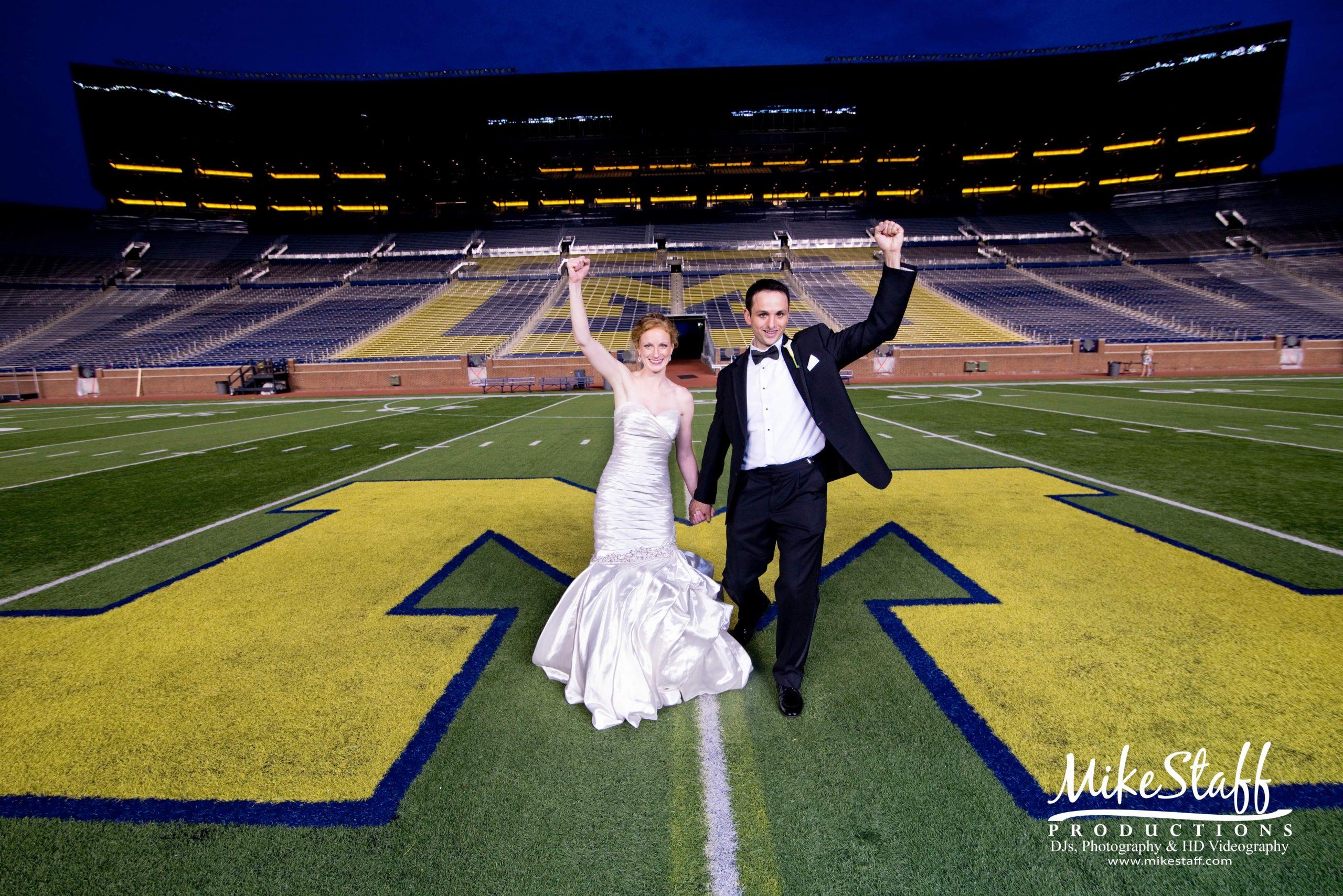 bride and groom on Michigan stadium field