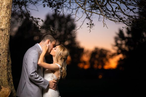 Bride and Groom kissing at Stonebridge