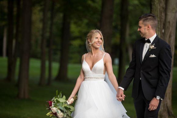 Bride and Groom walking at Cherry Creek Golf Club