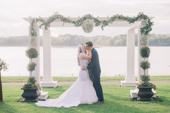Couple kissing at outdoor ceremony