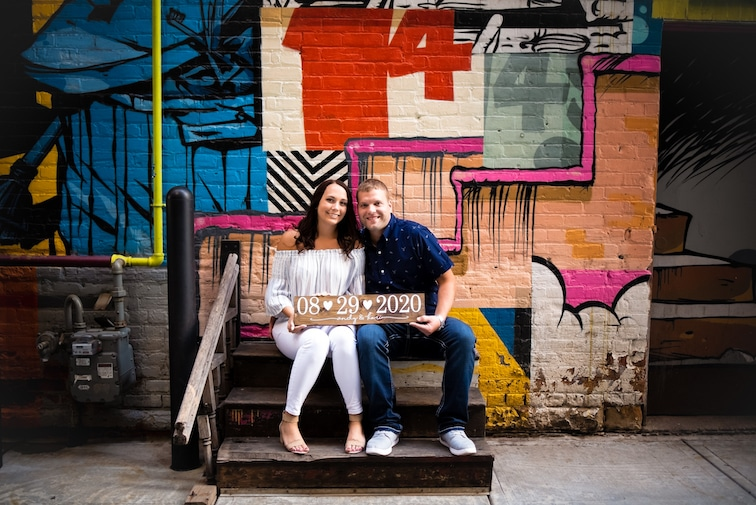 Engagement Session at The Belt in Detroit with wedding date sign