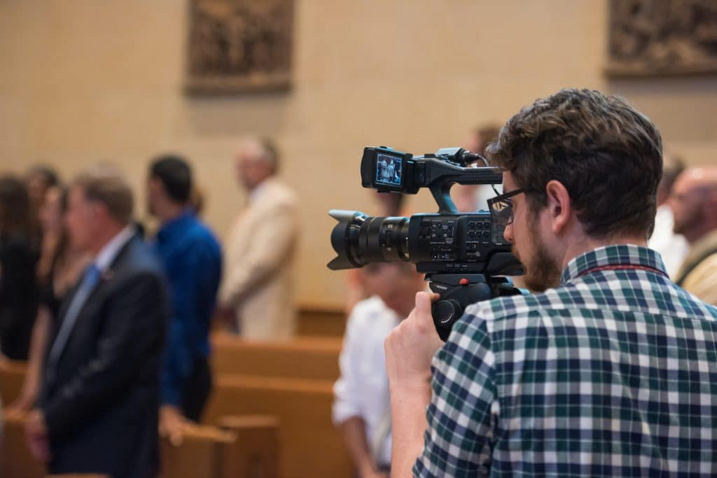 Videography filming church wedding ceremony