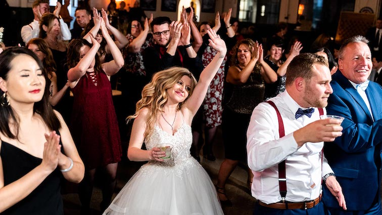 bride and groom dancing to wedding reception music