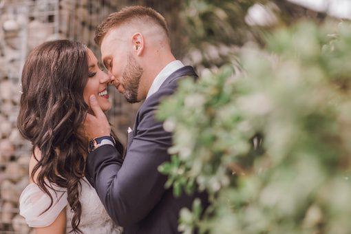 bride and groom kissing intimate wedding