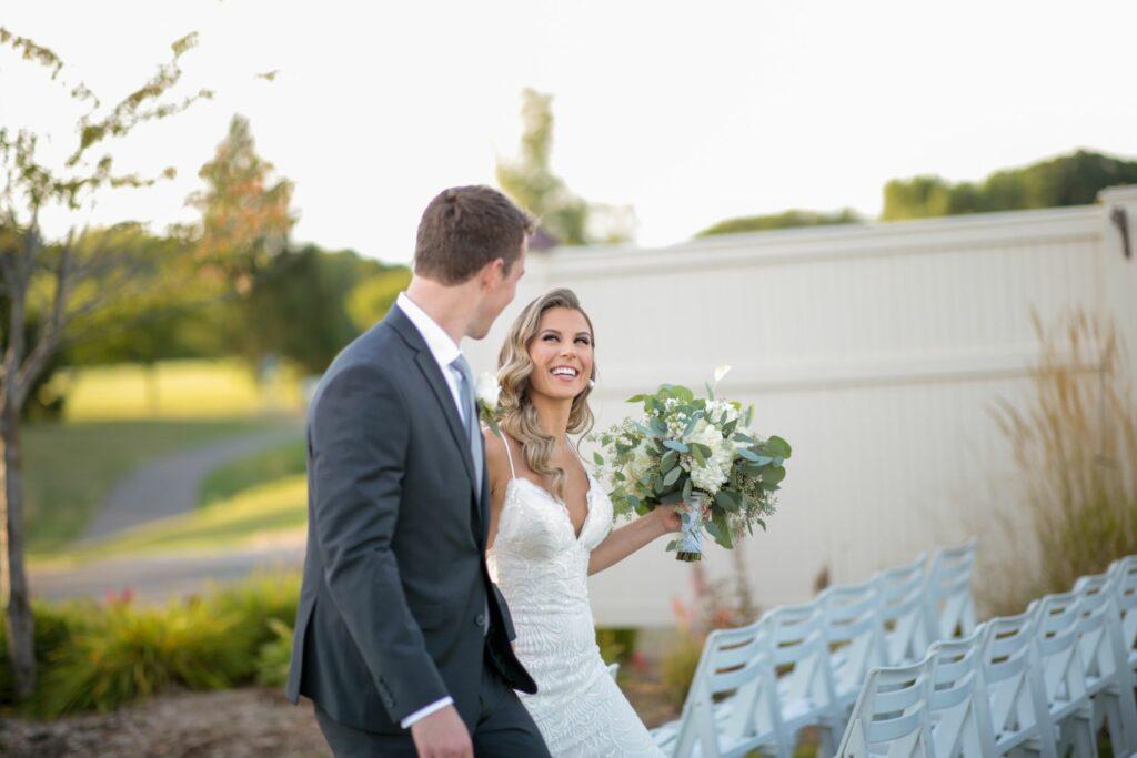 bride and groom walking glen oaks