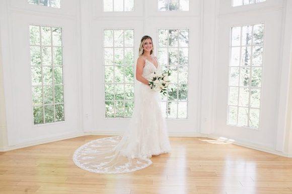 bride pre-ceremony with large windows