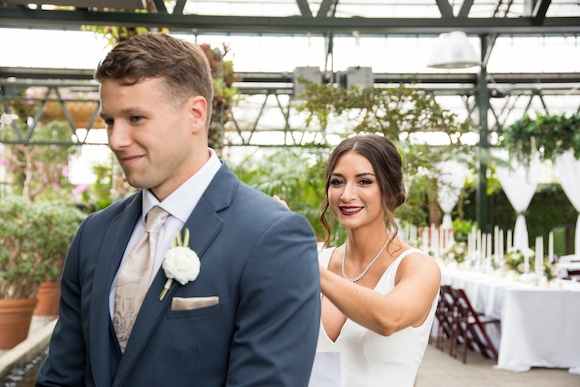 bride tapping groom's shoulder for first look