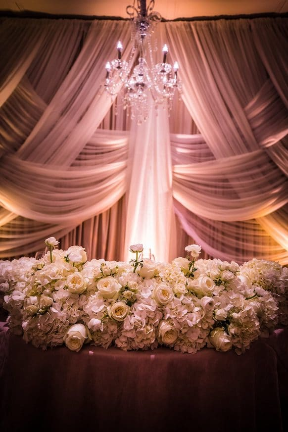 drapery white uplighting reception