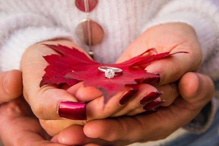 engagement ring on leaves in fall